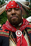 "Portrait of pow wow dancer of both Native American and African American descent at theThunderbird Powwow at the Queens County Farm Museum ....A pow-wow (also powwow or pow wow or pau wau) is a gathering of North America's Native people. The word derives from the Narragansett word powwaw, meaning ""spiritual leader""."