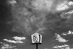 the new mexico sky surrounds a native american sign abstract landscape, at big chief gas station, san ysidro