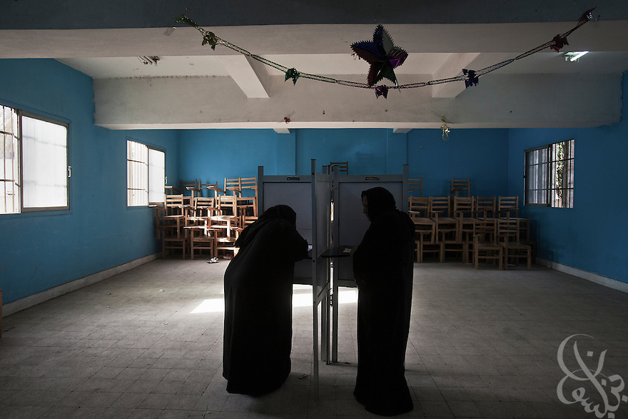 Egyptian women cast their votes during the second day of the historic democratic Presidential election May 24, 2012 in the Imbaba district of Cairo Egypt. Coming 15 months after the revolution that toppled the regime of former President Hosni Mubarak, the election will determine not only the country's leader, but will shape the future role of the military, and the direction and pace of social and democratic reforms. (Photo by Scott Nelson)