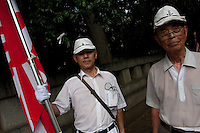 People dressed in pacific War era navy  uniforms during the commemoration of the end of the Pacific war at Yasukuni Shrine, Kudanshita, Tokyo, Japan. August 15th 2010