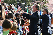 U.S. President Barack Obama (R) and British Prime Minister David Cameron greet the crowd during the official arrival ceremony at the South Lawn of the White House March 14, 2012 in Washington, DC. Prime Minister Cameron was on a three-day visit in the U.S. and he was expected to have talks with President Obama on the situations in Afghanistan, Syria and Iran.  .Credit: Mark Wilson - Pool via CNP