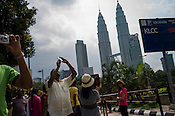 Tourists take photo of Petronas Twin Towers in Kuala Lumpur, Malaysia. Photo: Sanjit Das/Panos