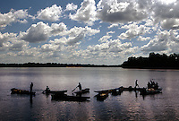 Women from local villages try to eke out  a living by fishing for aquarium fish outside Rockstone, Guyana.