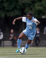 University of North Carolina midfielder Crystal Dunn (19) controls the ball.  University of North Carolina (blue) defeated Boston College (white), 1-0, at Newton Campus Field, on October 13, 2013.