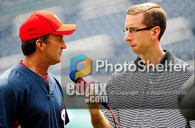 6 June 2010: Washington Nationals' radio broadcaster David Jagler (right) interviews Manager Jim Riggleman prior to a game against the Cincinnati Reds at Nationals Park in Washington, DC.  The Reds edged out the Nationals 5-4 in a ten inning game. Mandatory Credit: Ed Wolfstein Photo