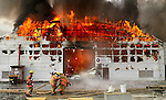 March 15, 2004 - Fire races through the ThermoFluids complex, also devouring businesses like this New Ventures Manufacturing &amp; Service, Inc. building.....KEYWORDS: Blaze, oil