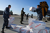 Sailors from Fleet Logistics Squadron (VRC) 30 load meat, bread and plastic dinnerware into C-2A Greyhound logistics aircraft at Naval Base Coronado, California on Tuesday, November 9, 2010. VRC-30 is transferring the supplies to the aircraft carrier USS Ronald Reagan (CVN 76), which will deliver them to the Carnival Splendor, a cruise ship stranded about 250 miles off California. .Mandatory Credit: Jeremy M. Starr - U.S. Navy via CNP