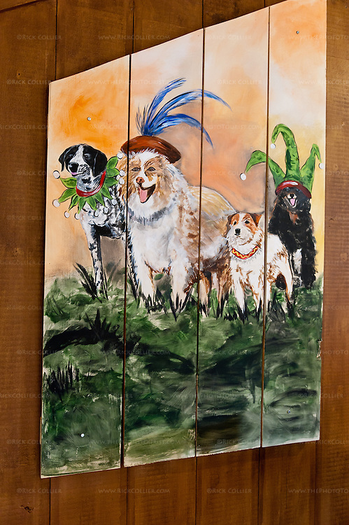 Whimsical hand-painted panels including this one of winery dogs adorn the tasting room at Vintage Ridge.