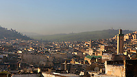 General view of Medina, Fez, Morocco, with the hilly landscape in the background, pictured on February 24, 2009 in the morning. Fez, Morocco's second largest city, and one of the four imperial cities, was founded in 789 by Idris I on the banks of the River Fez. The oldest university in the world is here and the city is still the Moroccan cultural and spiritual centre. Fez has three sectors: the oldest part, the walled city of Fes-el-Bali, houses Morocco's largest medina and is a UNESCO World Heritage Site;  Fes-el-Jedid was founded in 1244 as a new capital by the Merenid dynasty, and contains the Mellah, or Jewish quarter; Ville Nouvelle was built by the French who took over most of Morocco in 1912 and transferred the capital to Rabat. Picture by Manuel Cohen.