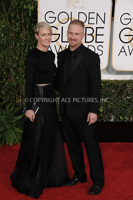 WWW.ACEPIXS.COM<br /> <br /> January 11 2015, LA<br /> <br /> Robin Wright and Ben Foster arriving at the 72nd Annual Golden Globe Awards at The Beverly Hilton Hotel on January 11, 2015 in Beverly Hills, California. <br /> <br /> <br /> By Line: Peter West/ACE Pictures<br /> <br /> <br /> ACE Pictures, Inc.<br /> tel: 646 769 0430<br /> Email: info@acepixs.com<br /> www.acepixs.com