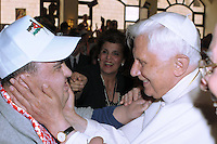 Pope Benedict waves to the faithful during his visit to the Lady of Peace Church, his first scheduled stop during his visit to Jordan, in Amman May 8, 2009..