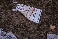 A sign is left on the ground near the U.S. Capitol following the Inauguration of President Barack Obama on Monday, January 21, 2013 in Washington, DC.