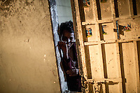 A mentally ill migrant in isolation in one of the Surman detention centres for illegal migrants on the west coast of Libya.