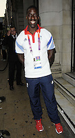 Dwain Chambers.The Prince Albert II of Monaco Olympians Reception, Old Burberry Building, Haymarket, London, England..August 9th, 2012.full length blue white t-shirt trousers medal winner .CAP/CAN.©Can Nguyen/Capital Pictures.