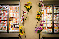 Artificial flowers are all that remain of a supermarket product display in the freezer section in New York on Tuesday, May 13, 2014. (© Richard B. Levine)