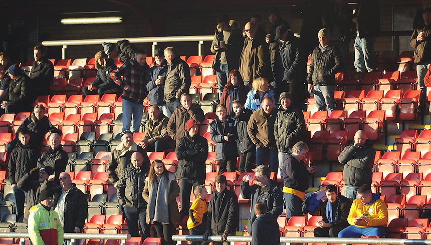 Preston North End fans during the pre-match warm-up <br /> <br /> Photographer Kevin Barnes/CameraSport<br /> <br /> Football - The Football League Sky Bet League One - Crewe Alexandra v Preston North End - Sunday 28th December 2014 - Alexandra Stadium - Crewe<br /> <br /> &copy; CameraSport - 43 Linden Ave. Countesthorpe. Leicester. England. LE8 5PG - Tel: +44 (0) 116 277 4147 - admin@camerasport.com - www.camerasport.com