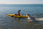 Dog races kayak — Cline Spit, Sequim WA