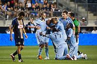 Graham Zusi (8) of Sporting Kansas City celebrates scoring with teammates. Sporting Kansas City defeated the Philadelphia Union 2-0 during the semifinals of the 2012 Lamar Hunt US Open Cup at PPL Park in Chester, PA, on July 11, 2012.