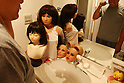 July 5, 2010 - Tokyo Japan - Ta-bo, an avid Love Doll collector, brushes his teeth while being watched by a few of his Love Dolls in Tokyo, Japan, on July 5, 2010. The 50-year-old Japanese engineer who rents a special three-bedroom apartment for his Love Dolls, says he owns more than one hundred, which is, to his mind, the world's largest collection of its kind.