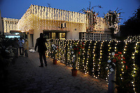 Lights decorate the groom's house where a reception for the wedding of British/Punjabi couple Lindsay and Navneet Singh will take place.