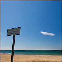 Sign on the beach with cloud