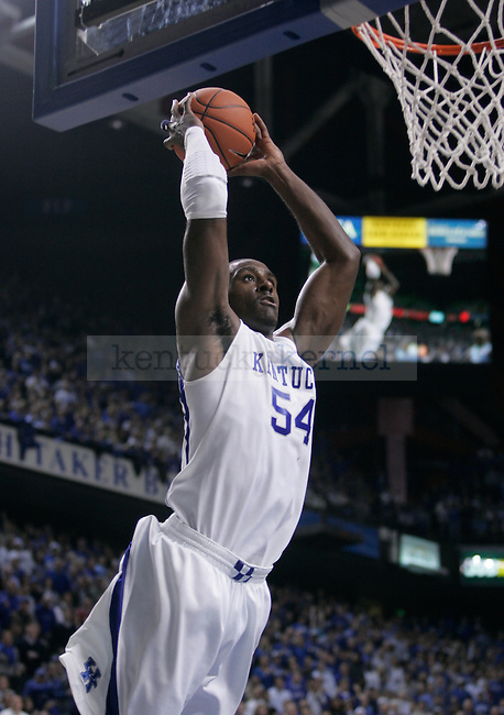 University of Kentucky junior forward Patrick Patterson dunks during the second half of UK's 68-66 win over UNC on Saturday, Dec. 5, 2009 in Rupp Arena...Photo by Ed Matthews | Staff