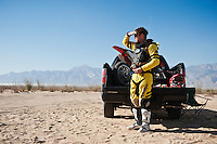 201x motorcycle rider Derek Duncan waits at race mile 58 for rider change, 2012 San Felipe Baja 250, San Felipe, Baja California, Mexico.