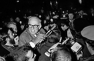 05 Dec 1967. New York, USA. Dr. Benjamin Spock is surrounded by reporters and police at an anti-Vietnam war protest at the Armed Forces Induction Center in New York City.