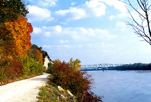 Former railroad bed turned into walking trail. The MKT trail on Missouri river in fall.