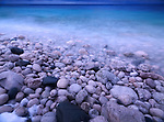 Pebbles on a shore of Georgian Bay. Wintertime scenic landscape. Bruce Peninsula National Park, Ontario, Canada.