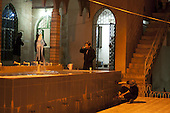BIARA, IRAQ: Students wash themselves before morning prayers...The Biara Madrassa--a religious school--is located high up in the mountainous Kurdish Hawraman region that makes up the Iran/Iraq border. Before 2003 the region was home to a fundamentalist Islamic group called Ansar al-Islam who used the school as a base. The Unites States military attacked the area and the madrassa numerous times during the 2003 invasion, finally pushing Ansar al-Islam out...Today the madrassa is home to 48 male students from all across Kurdish Iraq. The students leave their families and immerse themselves in their studies and the daily life of Koranic students...Photo by Besaran Tofiq