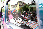 Dominican Republic:  Musicians, Dancers, Mayores  seen in the reflection of the Hummer SUV owned by GaGá leader Bleo as part of the GaGá  procession of El GaGá de San Luis....