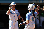 24 April 2016: North Carolina's Taylor Wike (7) and Kristen Brown (12) congratulate each other after scoring runs. The University of North Carolina Tar Heels hosted the University of Notre Dame Fighting Irish at Anderson Stadium in Chapel Hill, North Carolina in a 2016 NCAA Division I softball game. UNC won game 1 of the doubleheader 7-4.