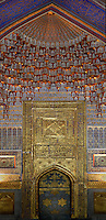 Detail of Mirhab of the mosque of the Tillyah-Kori Madrasah, 1646-60, Registan, Samarkand, Uzbekistan, pictured on July 15. The Tillyah-Kori (gilded) Madrasah is part of the Registan Ensemble. Commissioned by Yalangtush Bakhadur it is not only a school but also the grand mosque whose lavishly gilded main hall in Kundal style justifies the name. Samarkand, a city on the Silk Road, founded as Afrosiab in the 7th century BC, is a meeting point for the world's cultures. Its most important development was in the Timurid period, 14th to 15th centuries. Picture by Manuel Cohen.