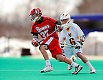 19 March 2011: St. John's University Red Storm Midfielder Connor Mullen, a Freshman from Romansville, PA, keeps one step ahead of UVM's Max Gradinger during action against the University of Vermont Catamounts at Moulton Winder Field in Burlington, Vermont. The Catamounts defeated the visiting Red Storm 14-9. Mandatory Credit: Ed Wolfstein Photo