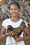 Srey Mao, 14, raises chickens in Khnach, a village in the Kampot region of Cambodia. Along with another sister, she lives with and takes care of her aging grandmother. Her parents died of AIDS.