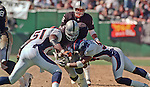 Oakland Raiders vs. Denver Broncos at Oakland Alameda County Coliseum Sunday, September 17, 2000.  Broncos beat Raiders  33-24.  Denver Broncos linebacker John Mobley (51) and linebacker Glenn Cadrez (59) stop Oakland Raiders running back Tyrone Wheatley (47).