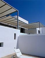 The rigid overhead sunshades on the terrace provide a shady refuge