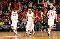 Dec. 17, 2010; Charlottesville, VA, USA; Virginia Cavaliers guard Jontel Evans (1) and Virginia Cavaliers guard K.T. Harrell (24) celebrate during the game against the Oregon Ducks at the John Paul Jones Arena. Virginia won 63-48. Mandatory Credit: Andrew Shurtleff