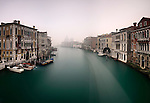 """An early, foggy morning view of the Canal Grande as seen from the bridge of Accademia, with the church of the Salute in the background. Taken on a morning of mid January about one hour after sunrise, this is stitched from five vertical frames each exposed for 120""""."""