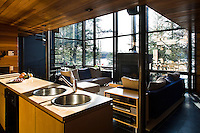 The free-standing kitchen island separates the kitchen from the open plan living area