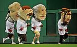20 June 2008: Washington Nationals' Racing President mascots run in the outfield during a game against the Texas Rangers at Nationals Park in Washington, DC. The Nationals rallied in the eighth to tie, and then win 4-3 in the 14th inning of their inter-league matchup...Mandatory Photo Credit: Ed Wolfstein Photo
