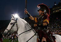 25 November 2006: Tommy Trojan &amp; Traveler enter the field at the start of the NCAA College Football final home game of the season for the University of Southern California USC Trojans with a 44-24 victory over the University of Notre Dame Irish at the LA Memorial Coliseum. USC moved up to the second spot in the BCS Poll with this win over ND.<br />