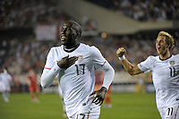 US forward Jozy Altidore (17) and midfielder Stuart Holden (11) celebrate after Altidore's goal put the US ahead 1-0.  The U.S. Men's National Team tied Poland 2-2 at Soldier Field in Chicago, IL on October 9, 2010.