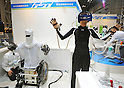 Nobember 9, 2011, Tokyo, Japan - A robotic device capable of feeding the wearer with 3D visuals is being demonstrated during the International Robot Exhibition 2011 opened in Tokyo on Wednesday, November 9, 2011. The three-day trade show, sponsored by the Japan Robot Association, was designed promote new products and develop new business through contributing the promotion of new technology. (Photo by Natsuki Sakai/AFLO) [3615] -mis-..
