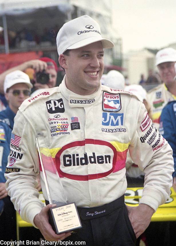 Tony Stewart celebrates after winning the IRL Indy Car race at Walt Disney World Speedway, Lake Buena Vista, FL, January 24, 1998.  (Photo by Brian Cleary/www.bcpix.com)