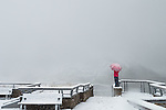 Woman with umbrella braving a snowstorm at Eielson Vistor Center, Denali National Park, Alaska
