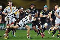 Niko Matawalu of Bath Rugby takes on the Wasps defence. European Rugby Champions Cup match, between Bath Rugby and Wasps on December 19, 2015 at the Recreation Ground in Bath, England. Photo by: Patrick Khachfe / Onside Images
