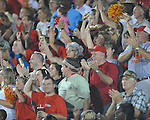Fans cheer as Lafayette High's Demarkous Dennis (5) returns a kickoff 95 yards for a score against Oxford at William L. Buford Stadium in Oxford, Miss. on Friday, September 2, 2011. Lafayette won 40-12