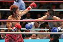 (L-R) Noriyuki Komatsu, Daisuke Naito (JPN), JUNE 27, 2006 - Boxing : Daisuke Naito of Japan in action against Noriyuki Komatsu of Japan during the OPBF and Japanese flyweight titles bout at Korakuen Hall in Tokyo, Japan. (Photo by Hiroaki Yamaguchi/AFLO)
